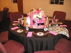 Barbie table setting complete with pink Barbie car flower arrangement