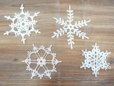 Set of 4 Crochet Snowflakes - christmas decoration ornament. $16.00, via Etsy.