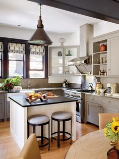 The family room has true white walls, while the kitchen cabinets were painted a…