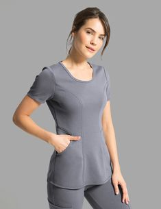 The Ponte Scoop Neck Top in Graphite is a contemporary addition to women's medical scrub outfits. Shop Jaanuu for scrubs, lab coats and other medical apparel. Vet Scrubs, Medical Scrubs, Spa Uniform, Scrubs Outfit, Lab Coats, Medical Uniforms, Womens Scrubs, Nursing Clothes, Moda Fashion