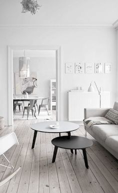 white living room black and grey round tables