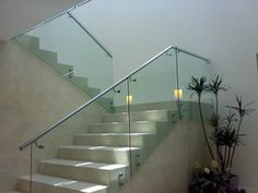 Like the filled in stair treads with the glass panels Glass Bannister, Glass Stairs, Glass Railing, House Wall Design, Steel Railing Design, Stair Banister, Stair Treads, Stainless Steel Staircase, Open Stairs