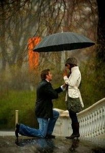 Romantic proposal in the rain
