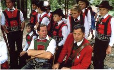 The highly decorative clothes worn by men on special occasions throughout the Tyrol are a direct result of the interest taken in local peasant clothing by the aristocracy and bourgeoisie from the middle of the 19th century. These men and boys in Austria wear typical leather shorts and red vests rooted in this delightful movement. - Ethnic Dress, Frances Kennett