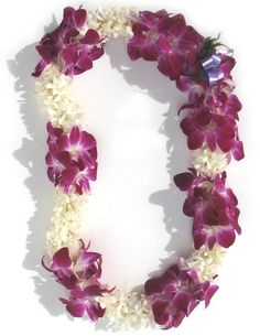 Double tuberose and orchid lei, for the bride. Gorgeous. I love the small of tuberose.