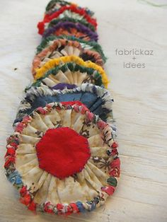 For some reason these tick all my boxes pretty lots of colour combinations gathering ruching good to hold maybethatsjustme – Artofit Fabric Beads, Fabric Ribbon, Fabric Art, Fabric Scraps, Textile Jewelry, Fabric Jewelry, Jewellery, Cloth Flowers, Fabric Flowers