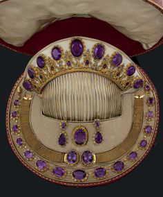 An antique gold and amethyst parure. The parure contained in a red Morocco case consisting of a comb, a necklace, a brooch, two bracelets and a pair of earrings. The comb, made in Paris, 1794-1797. #antique #parure