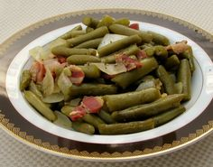 Tasty }- Texas Roadhouse Green Beans - We really like these green beans at TRH and after a little searching found this recipe.  Recipe is courtesy of WTVR, Richmond, VA.  When a friend of mine started working there, I asked if this is how they prepare their green beans and she shook her head yes, but said no with a smile.  I have included both variations for this recipe; choose the one to your liking.  Cook/simmer time is approximate.