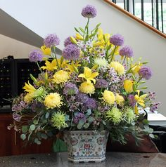 Arrangement from May 7, 2013:  yellow lilies, purple allium, yellow cushion mum, alstromeria, pink wax flower, and eucalyptus foliage