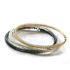 A trio combination of handmade bangles, the bangles are created in a rare wire crochet technique. This combo includes : 1. white silver 2. grey silver (oxidized) 3. yellow gold filled These 3 chic ban