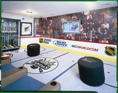 A cool Washington Capitals NHL man cave with a ice rink floor & hockey puck looking foot rests.