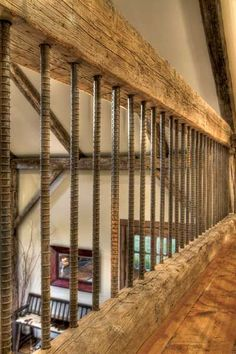 Leftover rebar was turned into a rustic railing adding depth and texture to the balcony and stairway--love this idea for a rustic home.Perfect for my basement stairs that will tie in with the rustic wall/tv center/shelves:) Future House, Stair Railing, Rebar Railing, Loft Railing, Banisters, Loft Stairs, Deck Stairs, Balcony Railing, Railing Design
