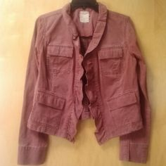 """Free People Rusty Ruffle 4 Pocket Jacket Free People, size small, in excellent condition! This spring military utility jacket is a rusty red brown color and 100% cotton. The color looks faded but is meant to look that way. Features four pockets on front, ruffles down the front, and three unique hook closures. Measurements are 18"""" pit to pit and 19.5"""" shoulder to bottom hem. Please ask any and all questions before purchasing. No trades. Make a reasonable offer. Thanks! Free People Jackets…"""