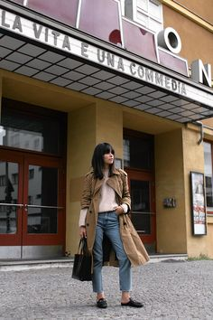 Nisi is wearing: Trench coat, Gucci Princetown Slipper, mom jeans, blush-toned knit, Saint Laurent Shopper - teetharejade.com