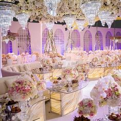 This spectacular Doha, Qatar wedding reception is a flower fantasy brought to life! From the centrepieces to the floral-ceiling and floral swings- there was no shortage of floral detail!  | WedLuxe Magazine
