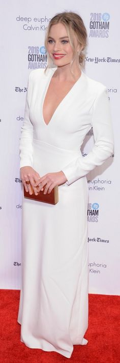 Who made Margot Robbie's white long sleeve gown and jewelry?