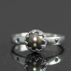 black-pearl-and-alexandrite-ring...June has 3 birthstones (pearl, moonstone & alexandrite)
