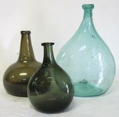 Group of blown chestnut and onion bottles. google.com