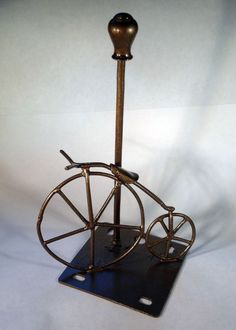 Metal art Big Wheel Bicycle rests on gas light by CreationDream