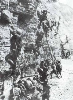 The first landing wave on Omaha Beach becomes pinned down; U.S. Rangers begin to scale Pointe-du-Hoc.