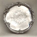 The Germain Silver Service or Portuguese Royal Service: Salver. 1762-63, Paris. The Portuguese Royal Coat of Arms is engraved in the center.