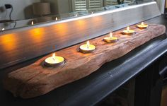 Perfect for the dining table, this stunning driftwood log tealight holder holds either 5 or 7 candles . Driftwood Table, Driftwood Art, Cornish Beaches, Tea Lounge, London Garden, Wood Candle Holders, T Lights, Scandinavian Home, Humble Abode