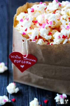 White Chocolate Popcorn- fun for Valentines- add candy conversation hearts too!