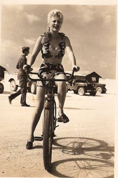 Lovely girl on bike. Found by Tommy Dorr of Lost and Found Vintage/bigphotographer      [I like it for capturing a moment in action and energy]