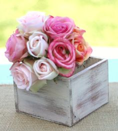What if we did the centerpieces out of live flowers, but they were planted not cut. That way they will last and ppl could take them home and put them on there front step. GOING GREEN :o)