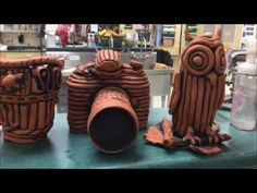 Ceramics I- Dipping the Themed Coil Pieces in Iron Oxide - YouTube