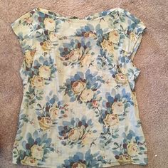 Anthropologie floral linen top Anthropolgie floral blouse. Vintage looking pattern. Top tie back detail. Very forgiving. It is a size 2 but I'm typically and size 4 on top. Anthropologie Tops Blouses