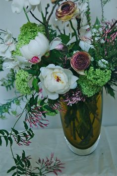 Early Spring flower arrangement with Peonies, Magnolia, Frittiliaria, Jasmine and Viburnum