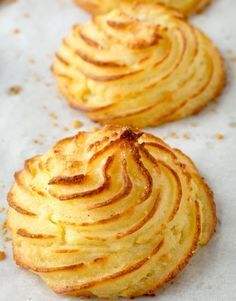 Rich and creamy inside with buttery, crispy exteriors, these Parmesan Duchess Potatoes are an easy way to elevate mashed potatoes for an impressive side. menu Duchess Potatoes Recipe with Parmesan Potato Sides, Potato Side Dishes, Batata Duchesse, Duchess Potatoes, Potato Puffs, Fingerfood Party, Food Mills, Side Dish Recipes, Easy Potato Recipes