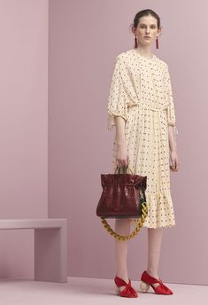 Mulberry Summer '18 LFW show. The Geraldine Dress in Antique Ruby Polka Dot Fil Coupe, Chandelier Earrings in Red Brass Metal & Enamel, Draped Pump Shoes in Red Satin and the  Marloes Hobo Bag in Antique Ruby Croc-Embossed Nappa Leather.