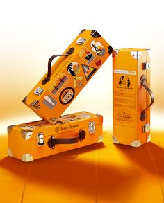 Sparkling Direct - - The Clicquot Trunk, crafted out of Veuve Clicquot yellow cardboard and leatherette, comes already emblazoned with part of its history through a set of stylized stickers. Bottle Packaging, Cosmetic Packaging, Brand Packaging, Packaging Ideas, Veuve Cliquot, Wine Meme, Vintage Champagne, Bottle Sizes, Packaging Design Inspiration