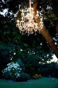 Chandeliers outdoors make for a stunning outdoor wedding lighting option.