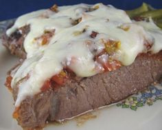 Italian Pizzaiola (Beefsteak Pizza Style) from Food.com:   This Italian steak is requested often by my family. I serve it with a fresh salad, warm bread, and with either mashed potatoes or pasta. The steaks make a very thin olive oil type sauce that can be used with the pasta. Don't forget the Chianti!