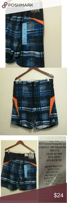 NWT Men's Swim Trunks Blue/Orange Med/Lrg +New with tags, perfect for family trips to Disney or vacation! ZeroXposur dude's/guys swim trunks shorts. Never tried on/used. Comfort inner liner and hidden coin feature. Blue/orange plaid watercolor pattern. UPF 50 and sizes Medium and Large available. +Makes a great Christmas gift! Bundle with my other men's/women's items or kids/baby clothes :-) Please ask any questions before buying. Smoke & pet free home. Thanks for shopping this WAHM's…