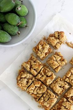 This Feijoa Crumble Slice is the perfect way to celebrate feijoa season! It's a quick easy slice with an oaty base, feijoa filling and a crumble topping that's perfect served as a warm dessert or as a lunchbox snack! Fejoa Recipes, Kiwi Recipes, Sweet Recipes, Baking Recipes, Dessert Recipes, Desserts, Recipies, Baking Ideas, Lunch Recipes
