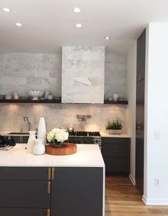 Stunning marble with open top shelves and black bottom cabinets for this stunning kitchen via greyandscout.com