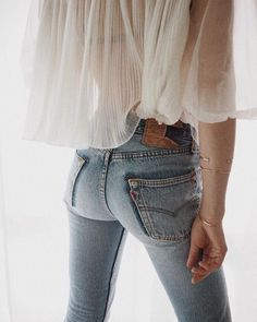 Washed blue jeans & white romantic blouse
