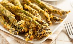 These garlic and 'Parmesan'-crusted asparagus spears make a tasty side dish, snack, or party appetizer. Easy and elegant!