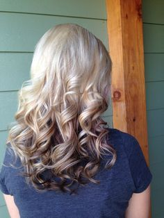 Blonde and dark blonde highlights with darker brown underneath, purple peek-a-boos, flat iron curls, Kenra color