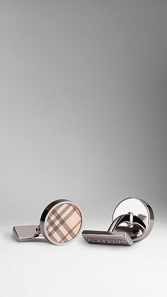 Burberry Sartorial round cufflinks with check-print enamel insert Polished metal frame and links $185.00