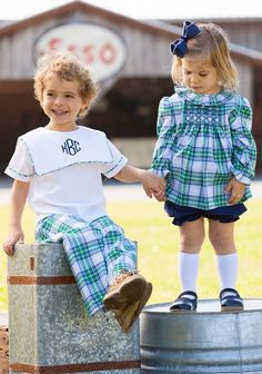 This adorable Navy Tartan Smocked Top is made of navy, green, and white fabric. The Navy Tartan Smocked Top is detailed with hand smocked navy thread. Pair with the rest of our Navy tartan collection for the cutest outfits around!  Poly-cotton blend, see size chart.