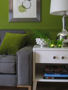 Green wall with gray couch