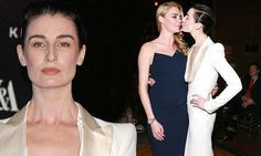 Jodie Kidd and Erin O'Connor share a cheeky kiss