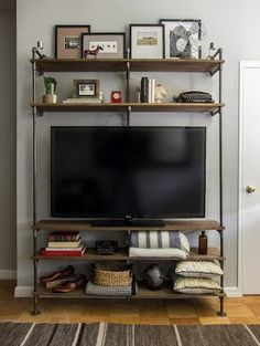 Industrial Pipe Shelving tv unit - to make with Grant! We'd have to modify it to fit what we need, but I love the look!
