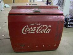 vintage coke cooler --My Papaw would reach in one of these and pull me out a chocolate pop. Was some of the best times ever!!