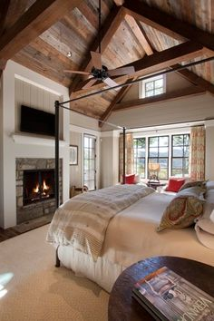 Country Master Bedroom with Ceiling fan, French doors, can lights, Exposed beam, Carpet, Cathedral ceiling, Paint, Fireplace